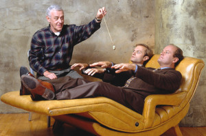 John Mahoney as Martin Crane, with Frasier and Niles laying down